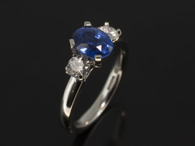 Platinum Trilogy Design with Oval Cut Sapphire 1.71ct and Round Brilliant Cut Diamonds 0.50ct Total