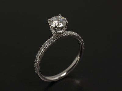 Platinum Claw set Design with Castle set shoulders and side set diamonds, Round Lab Diamond 0.70ct D VS2 EXEXEX