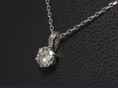 18kt White Gold Round Brilliant Cut Diamond, H I Colour, I Clarity (cust own). Millgrain bale with angled filed trace chain