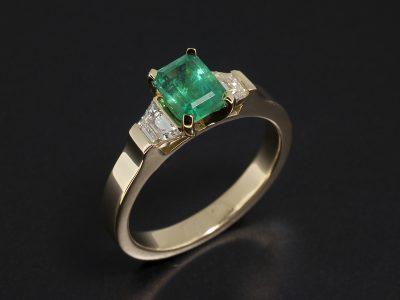 18kt Yellow Gold Trilogy Design wih Emerald Cut Emerald 1.06ct and Trapezium Cut Side Diamonds 0.37ct Total
