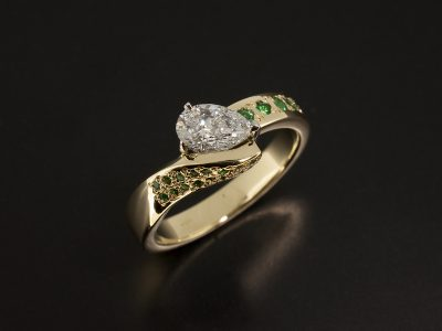 18kt Yellow Gold and Platinum Claw Set Twist Band Design with Pear Cut Lab Grown Diamond 0.66ct E VS2 VGVG and Pave set Round Brilliant Cut Emeralds x 23