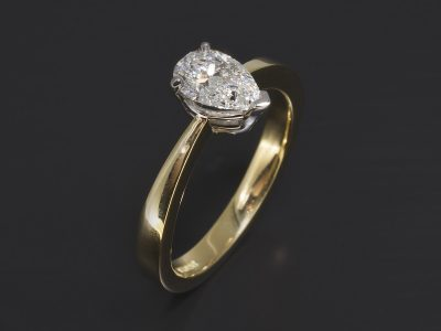 18kt Yellow & White Gold Claw Set Solitaire Design. Pear Shape Lab Diamond, 0.72ct. F Colour, VS2 Clarity.