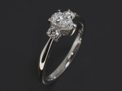 Platinum Claw Set Trilogy Design. Pear Shape LAB Diamond, 0.42ct. E Colour, VS2 Clarity Round Brilliant Cut Diamonds, 0.10ct (2).