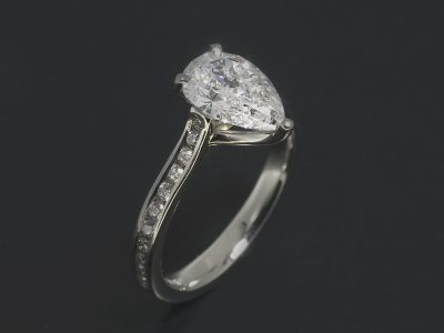 Platinum Claw and Channel Set Design. Pear Shape LAB Grown Diamond, 1.01ct. Round Brilliant Cut Diamonds, 0.22ct (22)