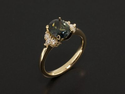 Oval Cut Green Sapphire 1.36ct with side Marquise and Round Brilliant Cut Diamonds in an 18kt Yellow Gold Claw Setting