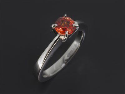 Platinum Four Claw Set Solitaire Design. Round Brilliant Cut Orange Sapphire, 0.73ct.