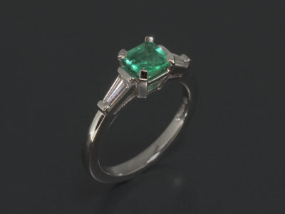 Platinum Claw Set Trilogy Design. Square Cut Green Emerald, 0.52ct. Tapered Baguette Lab Grown Diamonds, 0.30ct (2)
