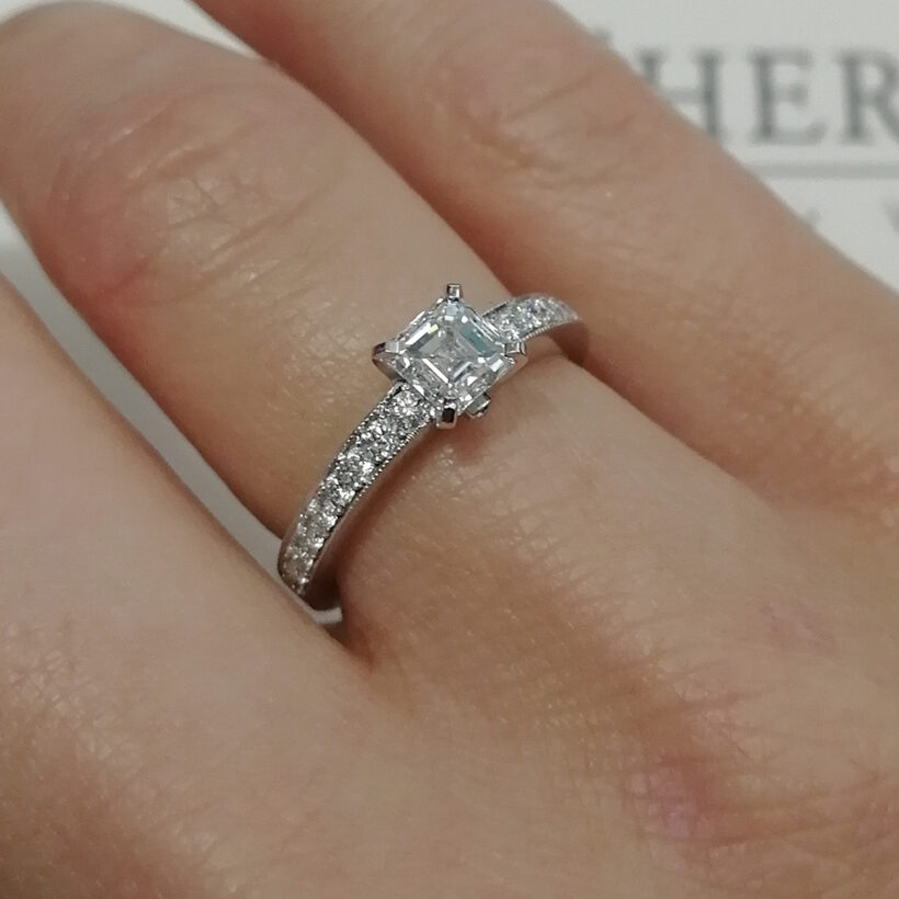 Asscher Cut Diamond Claw and Pavé Set Engagement Ring with Millgrain Detail