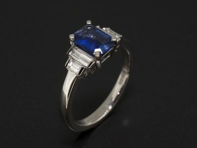 Emerald Cut Sapphire 0.89ct with Baguette Cut Diamonds 0.46ct Total in a Platinum Claw and Tension Set Design