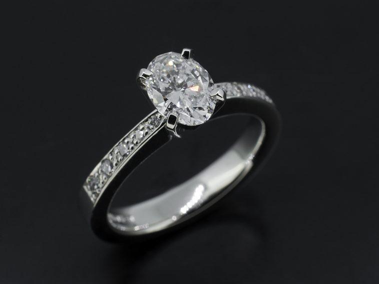 Platinum pave set oval diamond engagement ring 0.91ct
