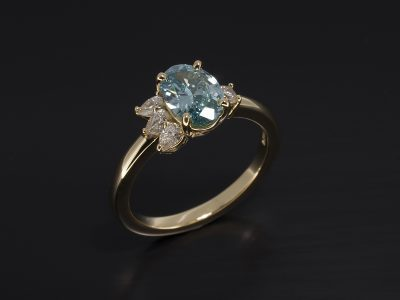 Oval Blue Diamond 0.89ct wih Pear Cut Diamonds 0.16ct Total and Round Brilliant Cut Diamond 0.05ct in a Claw Set 18kt Yellow Gold Design