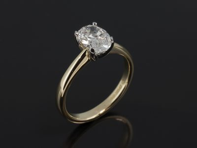 Oval Cut 1.42ct H Colour SI1 Clarity in a Platinum 4 Claw Tulip Shaped Setting with 18kt Yellow Gold Band