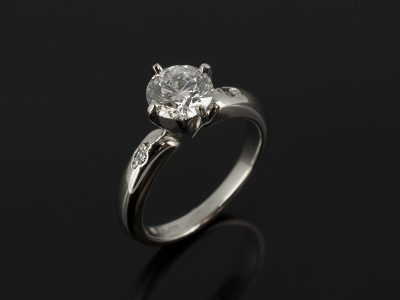 Platinum 4 Claw NSEW Compass Setting with Round Brilliant Cut Diamond 1.08ct D Colour SI1 Clarity Ex Cut, Polish and Symmetry with 2 x Round Brilliant Cut Diamonds Bead Set into Shoulders
