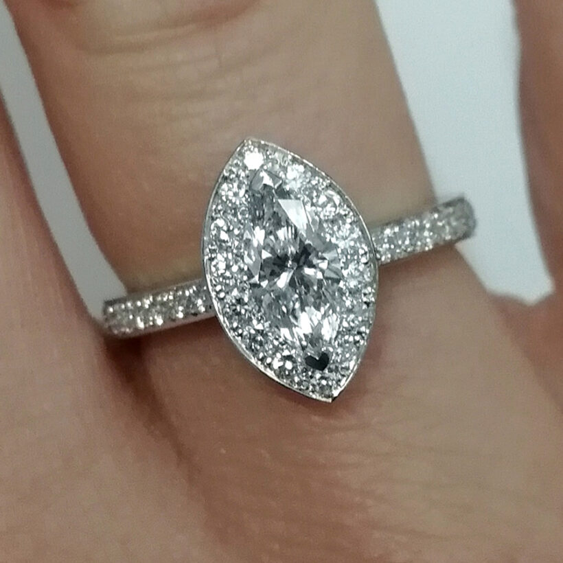 Marquise Cut Diamond Platinum Claw and Pavé Set Halo Design Engagement Ring