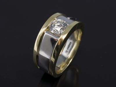 Platinum & 18kt Yellow Gold Tension Set Design. Round Brilliant Cut Diamond, 0.91ct, E Colour, SI2 Clarity.