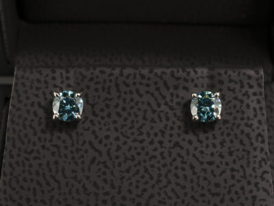 Platinum 4 Claw Earrings with Round Brilliant Cut Treated Blue Diamonds 0.61ct Total