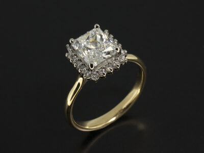 Platinum claw set halo engagement ring with Radiant Cut centre stone and 18kt yellow gold band