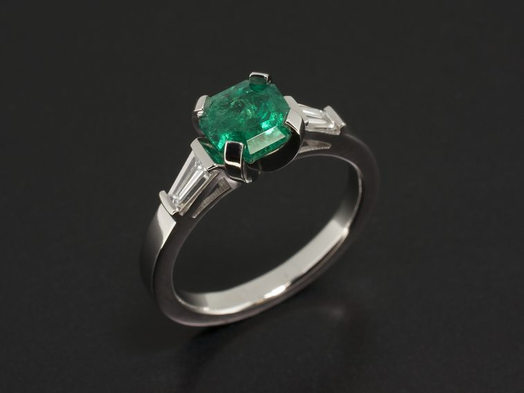 Platinum Claw Set Trilogy Design with Asscher Cut Emerald 1.16ct and Tapered Baguettes 0.37ct Total