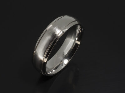 Platinum Court Shaped Gents Wedding Ring with Grooved Lines and a Brushed and Polished Finish