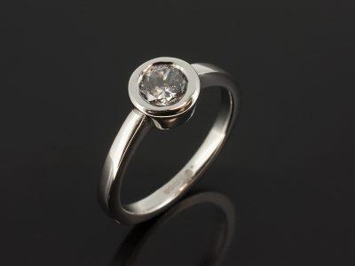 Platinum Rub Over Set Solitaire Design with Round Brilliant Cut Diamond 0.65ct