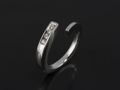 Platinum Twist Design Fitted Wedding Ring with Channel Set Round Brilliant Cut Diamonds 0.12ct Total