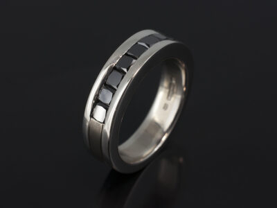 Platinum and 18kt White Gold Two Tone Gents Wedding Ring with Channel Set Square Black Diamonds