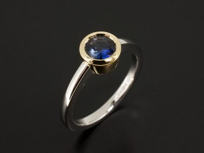 Round Blue Sapphire 0.81ct in an 18kt Yellow Gold Rub Over and Platinum Design