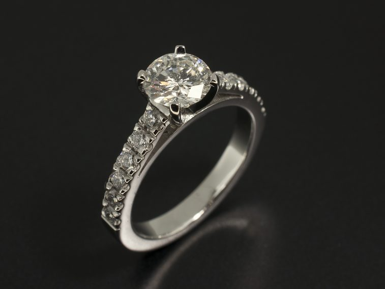 Round Brilliant Cut 0.71ct H SI2 in a 4 Claw Solitaire Design with Castle Set Shoulders