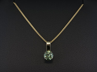 18kt Yellow and White Gold Claw Set Solitaire Coloured Diamond Pendant, Round Brilliant Cut Treated Green Diamond 0.77ct
