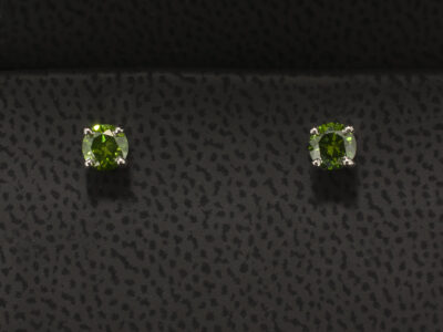 Round Brilliant Treated Green Diamond Earrings 0.56ct Total in Platinum 4 Claw Settings