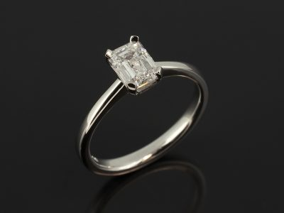Emerald Cut Lab Grown Diamond 0.92ct E Colour VS2 Clarity Ex Polish Ex Symmetry in a Platinum 4 Claw Tapered Basket Setting with Fine Band