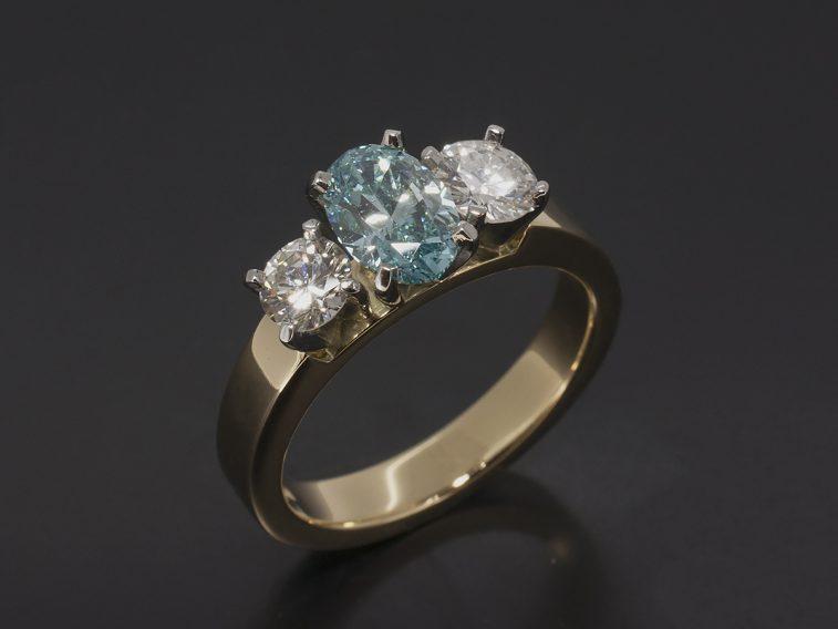 Platinum & 18kt yellow trilogy design. oval blue 0.89ct, rbc diamond 0.69 (2)