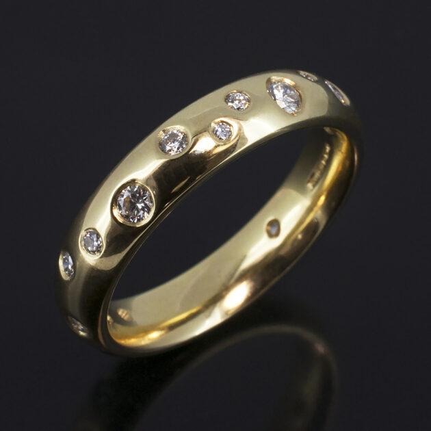 18kt Yellow Gold 4mm Scattered Diamond Design. Round Brilliant Cut Diamonds, 0.30ct (16). F Colour, VS Clarity Minimum.