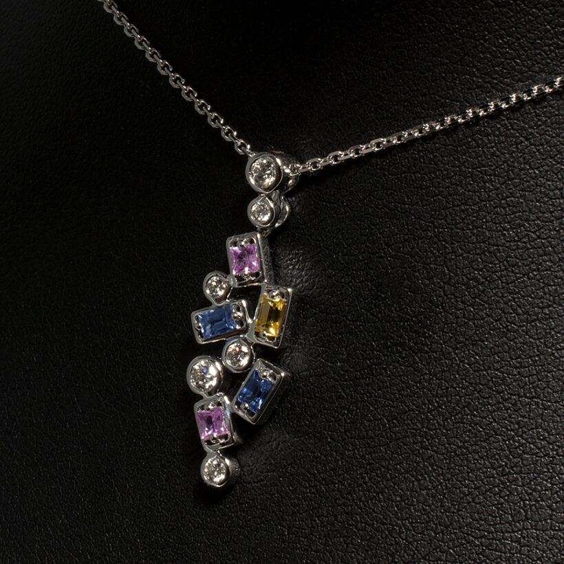 18kt White Gold Rub Over Set Diamond and Multi Coloured Sapphire Pendant
