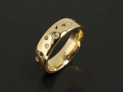 18kt Yellow Gold Secret Set Scatter Eternity Ring with Round Diamonds 0.15ct Rubies 0.07ct and Green Diamonds 0.06ct