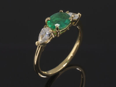 18kt Yellow Gold Claw Set Design. Oval Cut Emerald 0.61ct 7x5mm. Pear Cut Diamonds, approx 0.20ct (2). F Colour SI Clarity Minimum