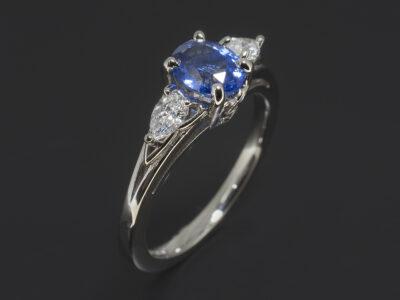 Platinum Claw Set Celtic Trilogy Design. Triquetra Detail Band. Oval Cut Sapphire 1.02ct. Side Pear Cut Diamonds approx. 0.23ct (2)