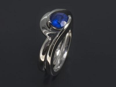 Platinum Half Rub Over Tension Set Twist Design Ladies Ring, Round Sapphire, 0.89ct. Platinum Fitted Twist Design