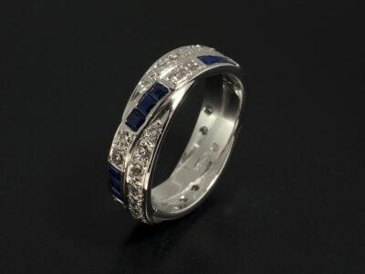 Platinum Channel and Pavé Set Square Sapphire and Round Brilliant Cut Diamond Twist Design Dress Ring