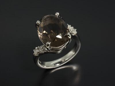 Platinum Claw Set Twist Design with Oval Cairngorm Quartz 7.87ct and Round Brilliant Cut Diamonds 0.45ct Total