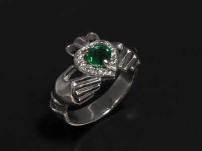 Platinum Claw and Pavé Set Claddagh Design with Hear Shaped Emerald 0.53ct and Round Brilliant Cut Diamonds 0.26ct Total