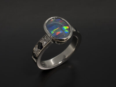 Platinum Rub Over and Pavé Set Design with Cabochon Cut Opal, Round Brilliant Cut Diamonds 0.13ct and Round sapphires 0.41ct