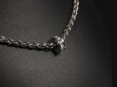 18kt White Gold Channel Set Circular Design Diamond Charm Necklace, Round Brilliant Cut Diamonds 0.44ct Total on a Spiga Chain
