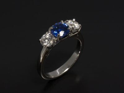 18kt White Gold Claw Set Trilogy Design with Round Brilliant Sapphire 1.05ct and Round Brilliant Cut Lab Diamonds 0.80ct Total