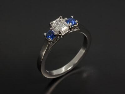 Platinum Claw Set Trilogy Design with Emerald Cut Lab Grown Diamond 0.51ct E Colour VS1 Clarity and Asscher Cut Side Sapphires 0.29ct