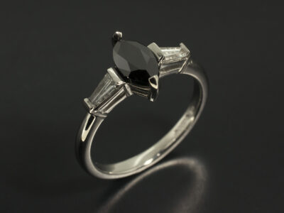 Platinum Claw Set Trilogy Design with Marquise Black Diamond 0.69ct and Tapered Baguette Cut Lab Grown Diamonds 0.25ct