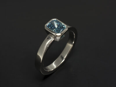 Platinum Rub Over Set Contemporary Design with Radiant Cut Lab Grown Blue Diamond 1.12ct VS1 Clarity