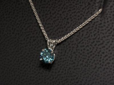 Platinum 4 Claw Set Coloured Diamond Solitaire Pendant, Round Brilliant Treated Blue Diamond 0.70ct, Split Bale Detail on a Spiga Chain