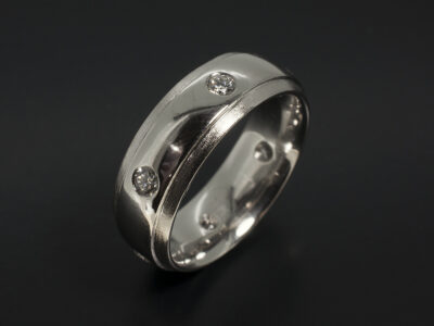 Gents Wedding Ring in Platinum Secret Set with Six Round Brilliant Cut Diamonds 0.67ct Total in a Polished and Flail Finish