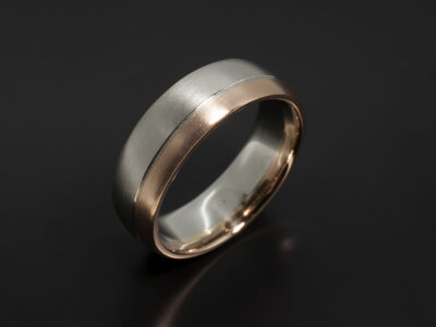 Two Tone Gent's Wedding Ring in Platinum and 18kt Rose Gold with Grooved Line Detail and Brushed finish